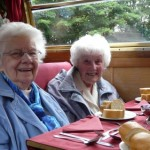 Dorothy and Mildred wait patiently for lunch to be served
