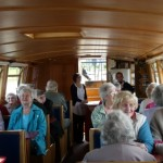 Everyone sitting comfortably in the spacious barge.
